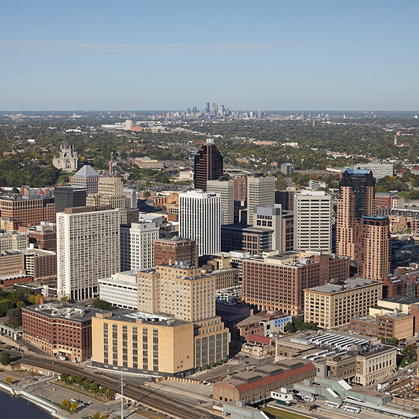 Aerial photo of Downtown St. Paul with Downtown Minneapolis in the background.