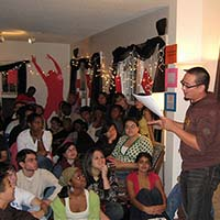 Photo of a crowd of students listening to a slam poet