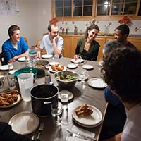 Photo of students gathered over dinner