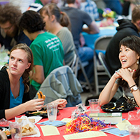 Photo of students sitting at a table at Sophomore Fiesta