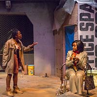 Photo of two students on stage in a play