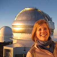 Photo of a student in front of the Macalester observatory