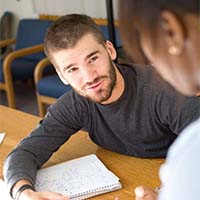 Photo of one student tutoring another