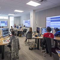 Photo of students working in an editing lab