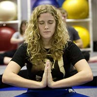 Photo of a student doing yoga in the gym