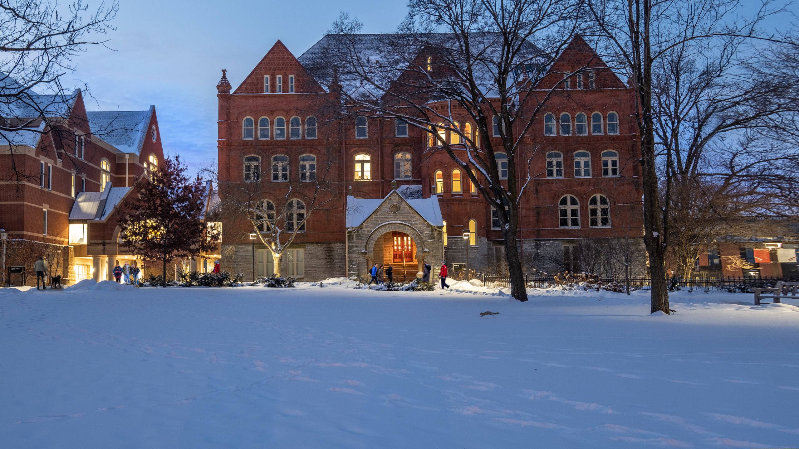 Old Main Hall and the DeWitt Wallace Library on a winter evening.