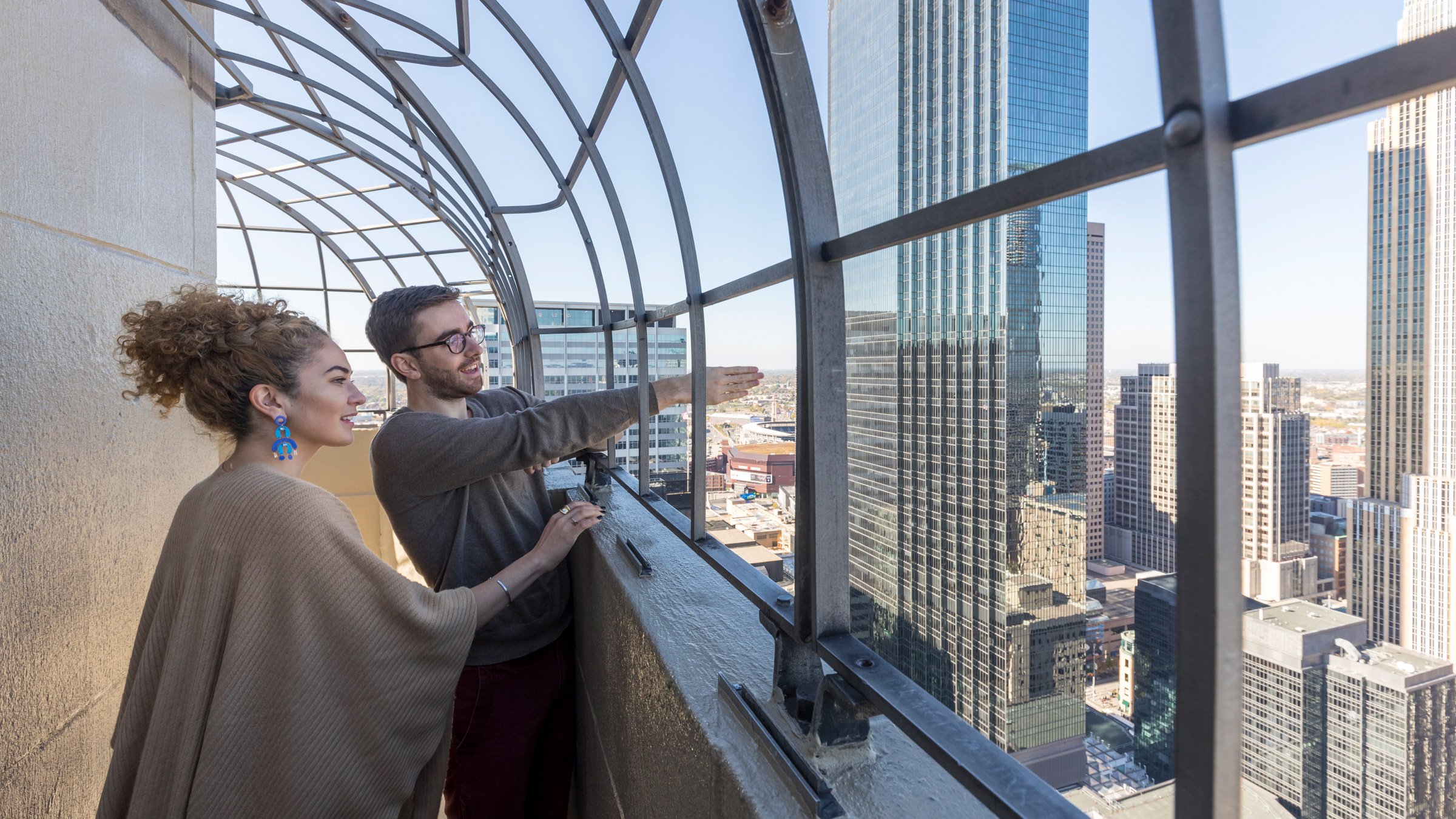Students looking out from an observation deck at Downtown Minneapolis.