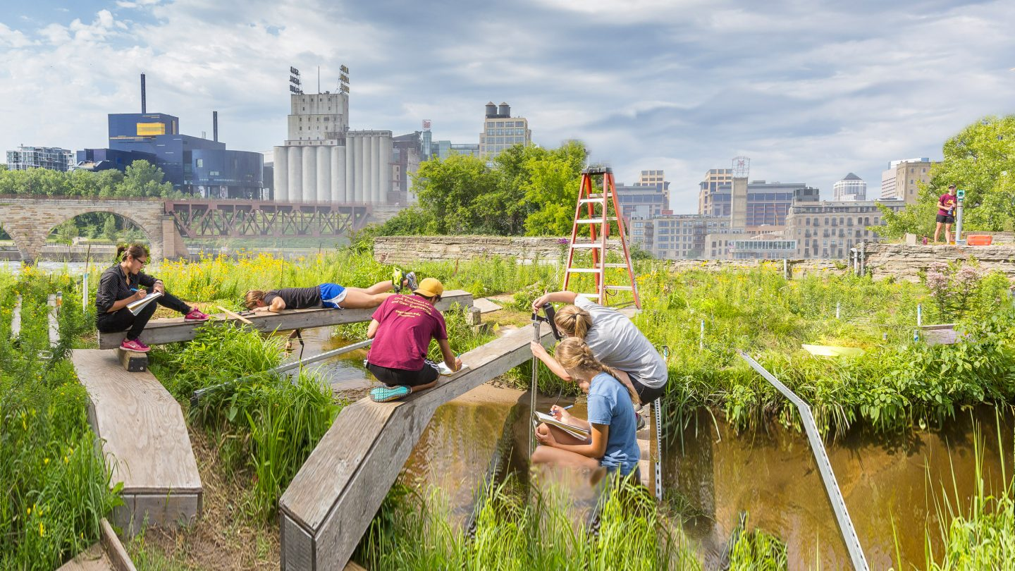Students making scientific observations next to the Mississippi River in Downtown Minneapolis.