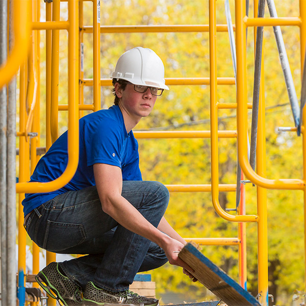 Student volunteering at a construction site.