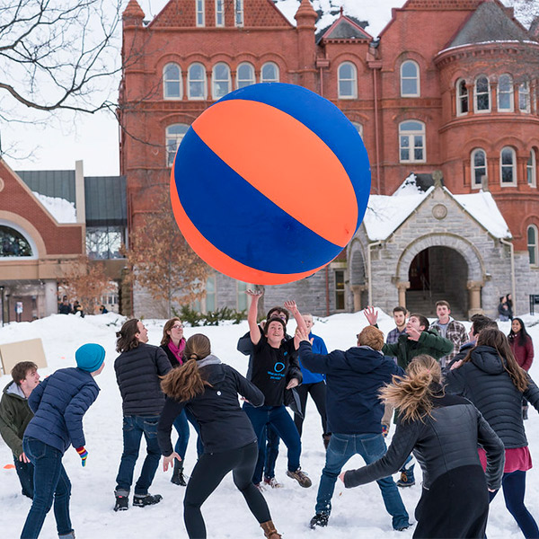 Students playing pushball in the snow in front of Old Main Hall.