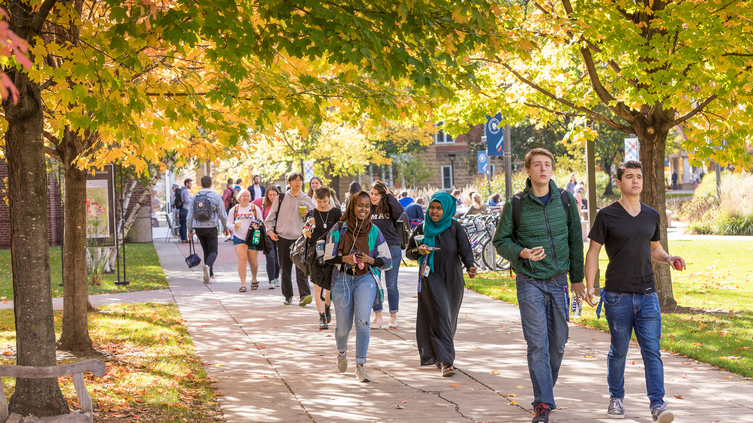 Students walking on the Macalester campus in autumn.