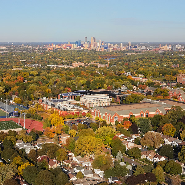 Aerial photo of the Macalester campus with Downtown Minneapolis in the background.