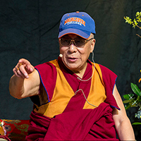 Photo of the Dalai Lama during a 2014 visit to Macalester.