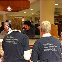 Photo of two professors serving students Midnight Breakfast.