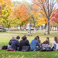 Photo of a class meeting outside on an autumn day