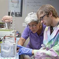 Photo of a student and a professor working together in a science lab