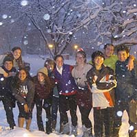 Photo of a group of students smiling in snow
