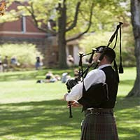 Photo of a man playing bagpipes