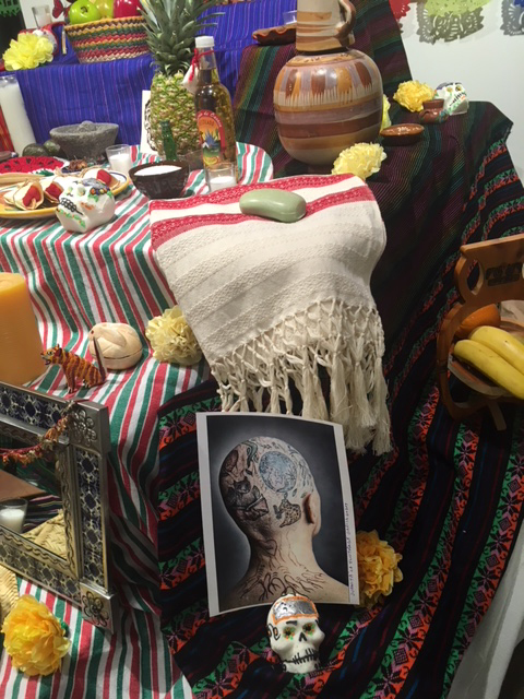 Day of the Dead Ofrenda Altar in the Art Lounge, feauturing photo of former Spanish Professor, Juanita Garcia Godoy, 2019.