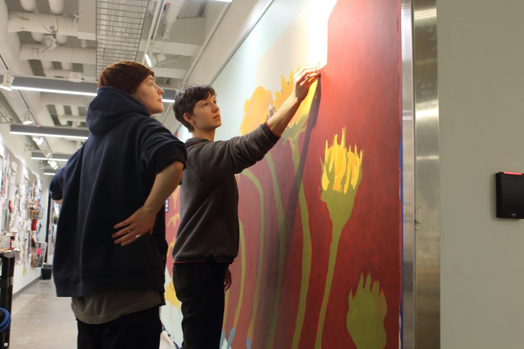 Sydney Petersen '19 and Phoebe Mol '19 working on a new mural for the Art & Art History department.