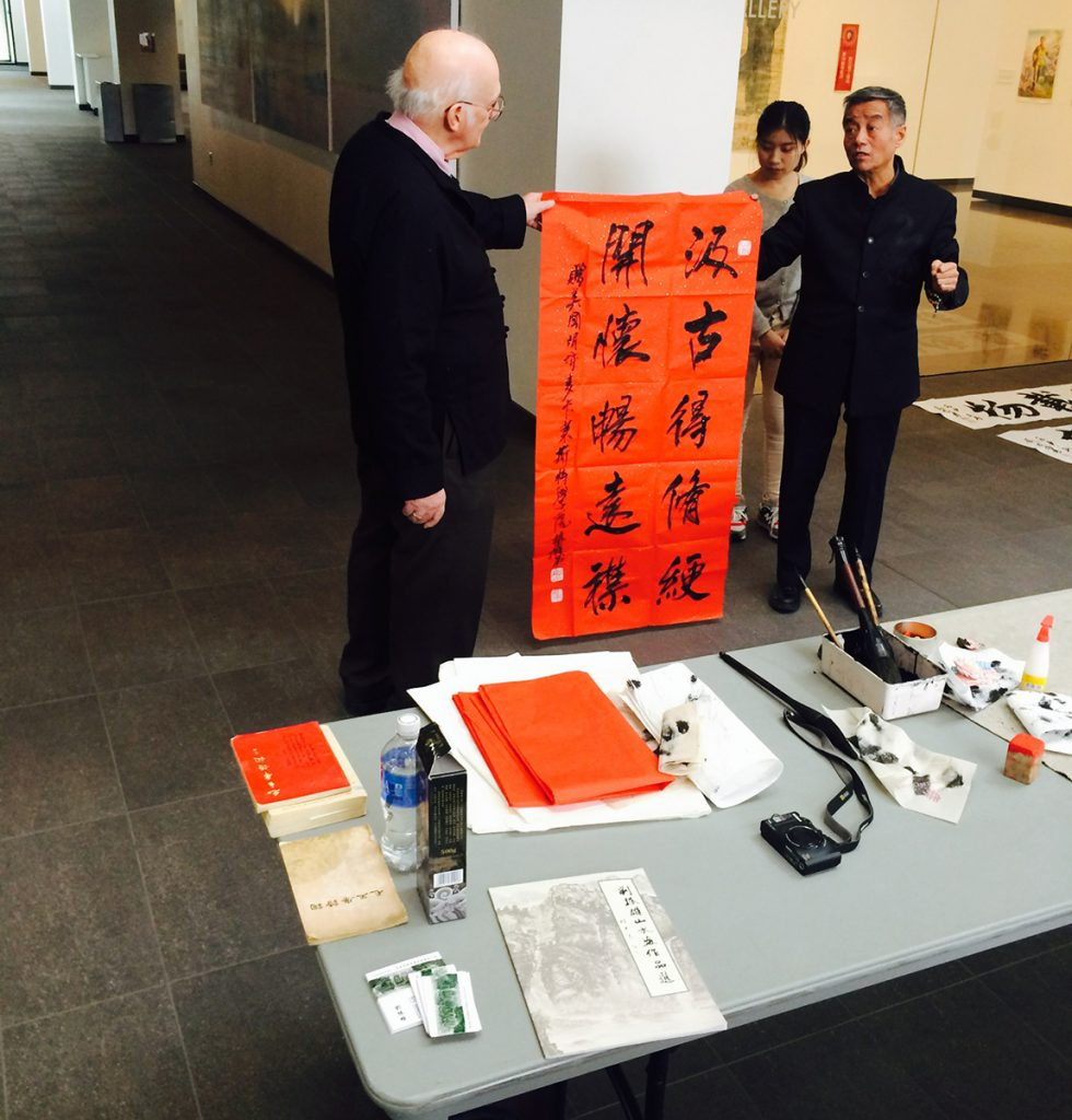 Liu Zhenxiong gives a Chinese calligraphy demonstration in the Arts Commons, 2016