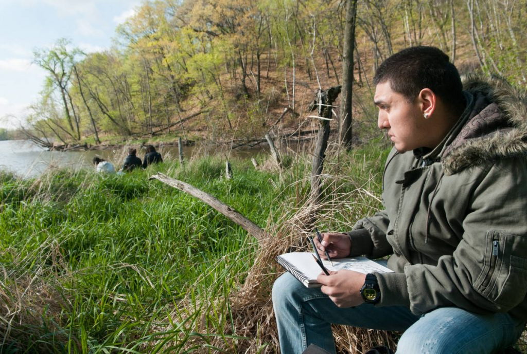Student Antonio Sanchez Drawing at the Katherine Ordway Natural History Study Area