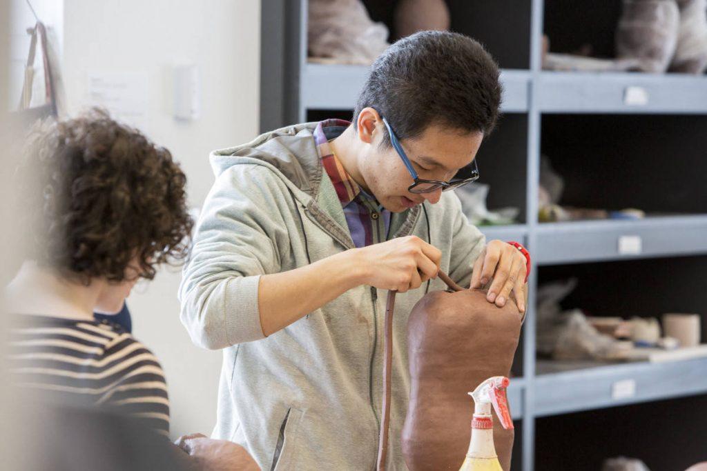 Student Hao Guo Working in the Ceramics Studio
