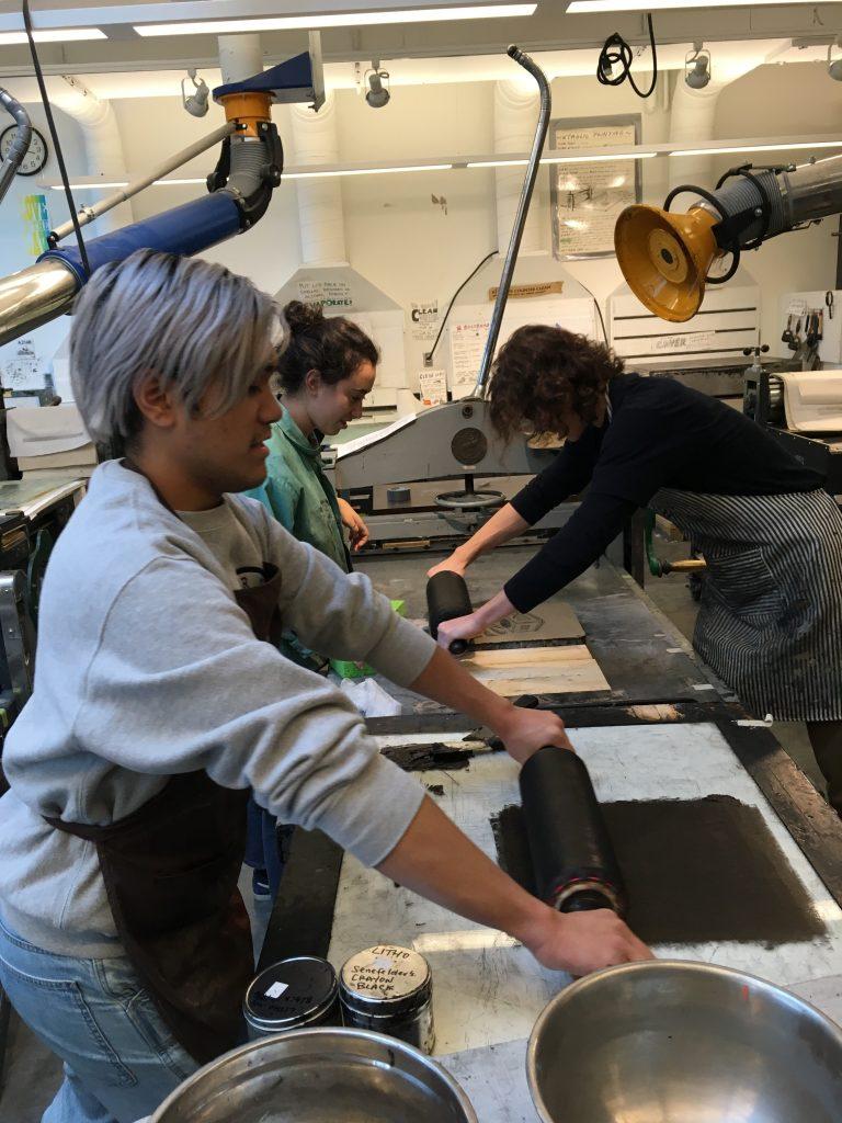 Angelo Perez, Allegra Berman, & Brett Hunsanger printing stone lithographs, 2019.