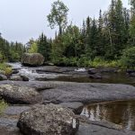 Photo showing a stream with large boulders in the Boundary Waters Canoe Area Wilderness