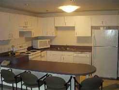 A kitchen in a Grand-Cambrige Apartment unit
