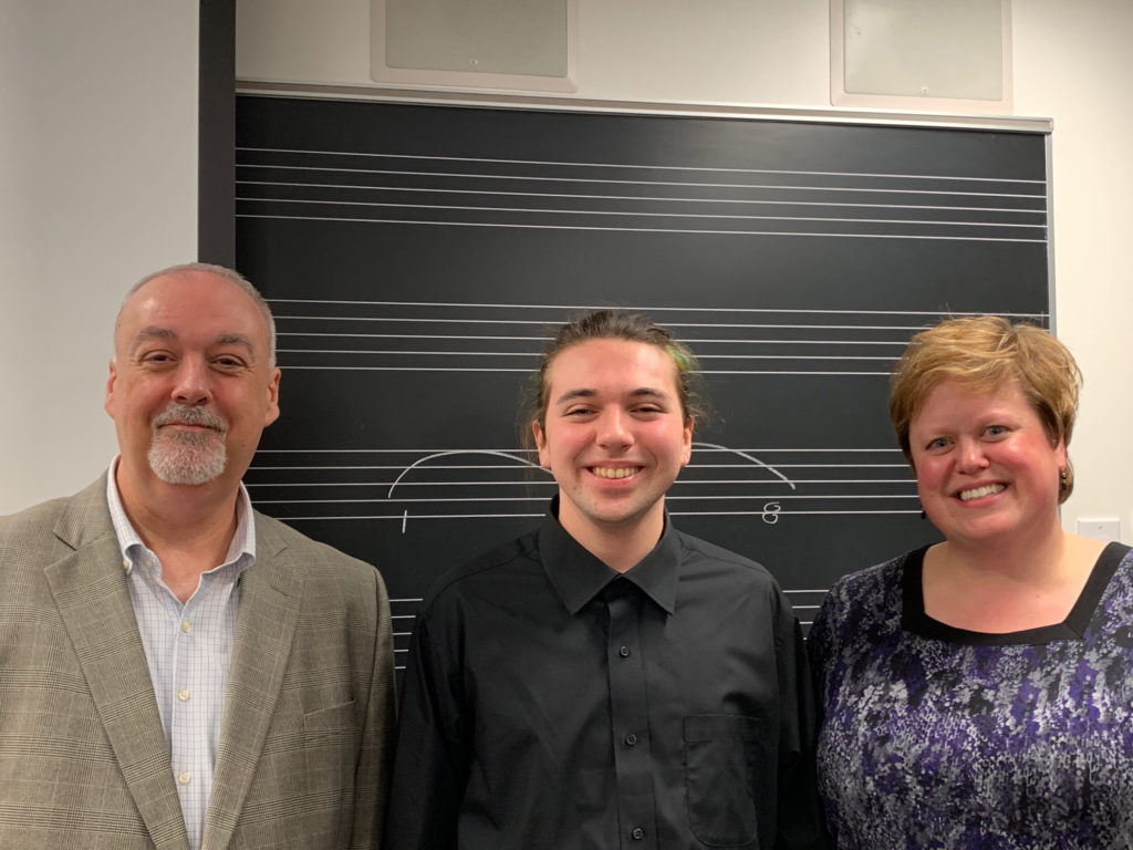 Visiting Instructor Claude Cassange on November 12 at his French Lecture with student Henry McKenna and Macalester pianist Mindy Eschedor.