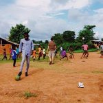 Photo showing community members playing soccer in Ghana