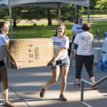 Student leaders help new students move-in on the first day of New Student Orientation.