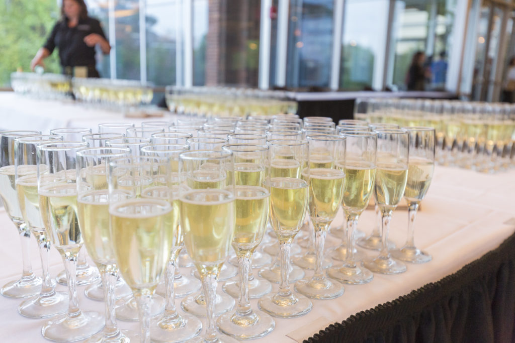 Glasses of champagne ready to toast the senior class.