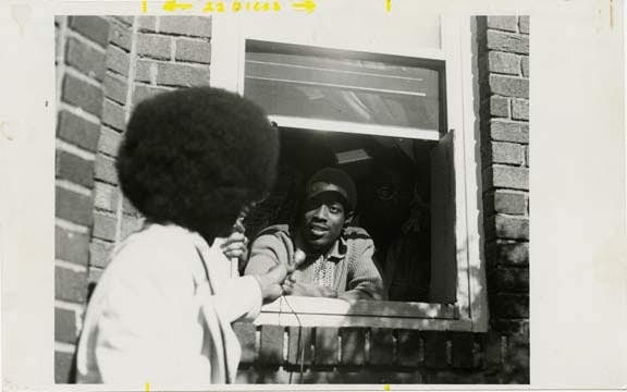 Melvin Collins being interviewed during takeover of 77 Mac, 1974