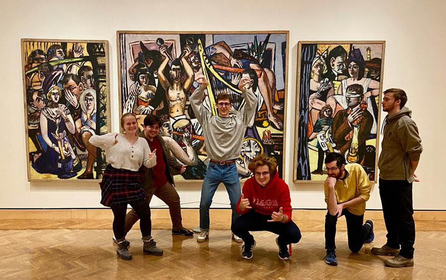 Students posing in front of artwork at MIA.