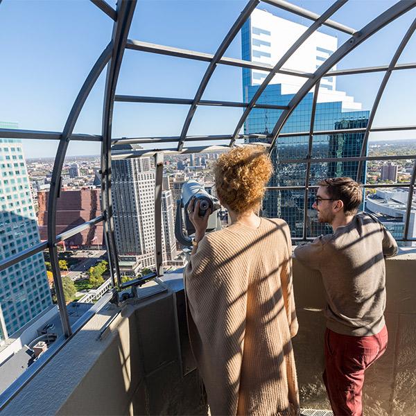 Students looking at Downtown Minneapolis from an observation deck.