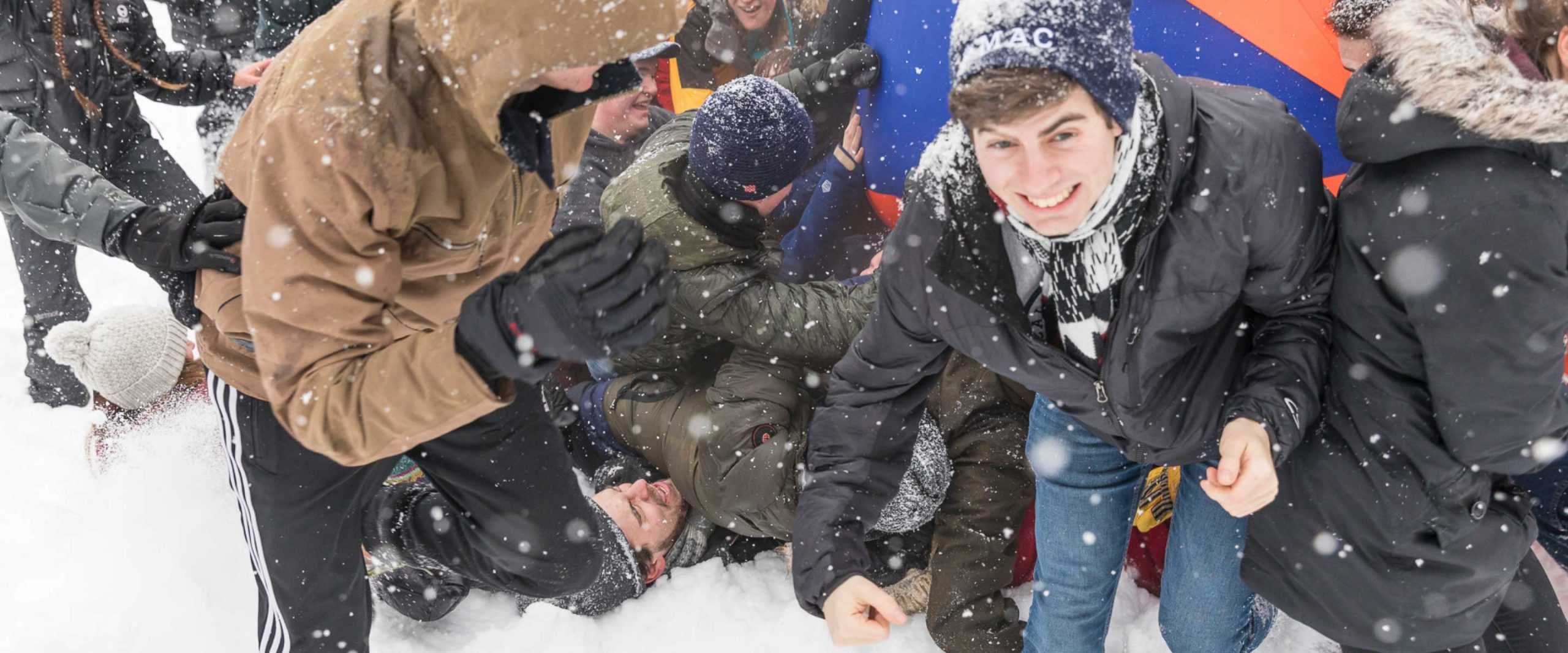 Students playing pushball in the snow.