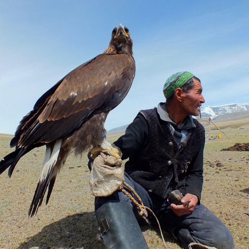 Mongolian hunter with an eagle on his arm.