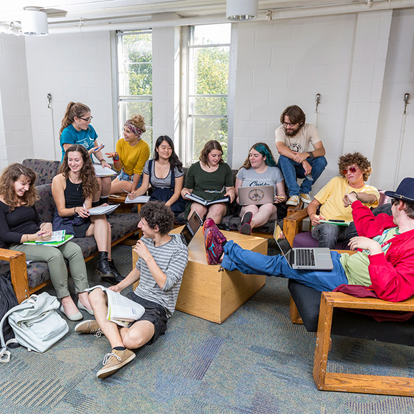 Students gathered in a common room in a residence hall.