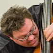 Adam Linz headshot and standup bass