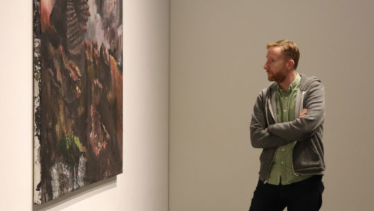 image of art with person looking at it