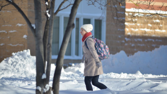 Image of student walking in winter