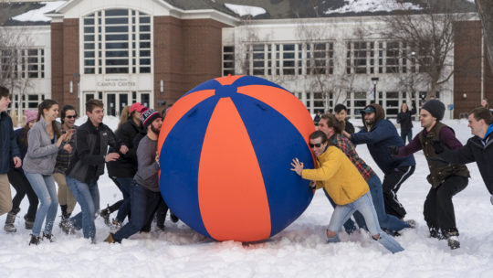 image of students playing pushball