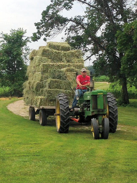 Lisa Moldan '10 and her husband Nate Fredrickson work on a fourth-generation farm. Their children, Adrian (3) and Isla (1, not pictured) pitch in with farm projects.