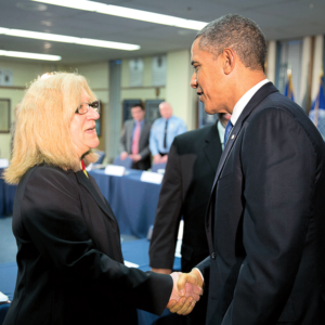 Susan Abderholden '76 shaking hands with former President Barack Obama
