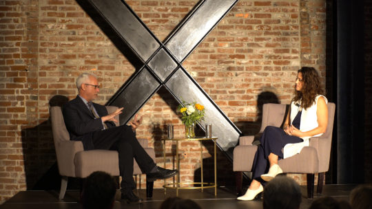 Photo of President Brian Rosenberg interviewing Professor Andrea Kaston Tange.