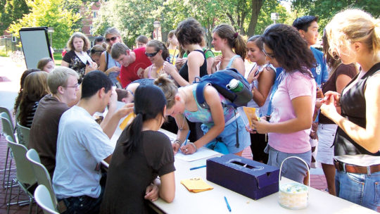 Photo of students registering other students for a wellness program