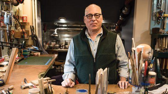 Photo of Howard Zitsman in his jewelry studio