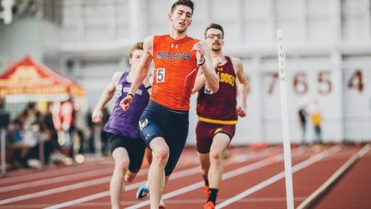 Photo of David Palmer and two non-Macalester athletes running